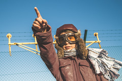 DSC_3471 (IILife) Tags: kid boy young dreamer dreaming hope fly flight aviator pilot old vintage glasses grunge leather airport aviation blue sky flightflying finger playing aircraft dream hoping male caucasian face nikon d5