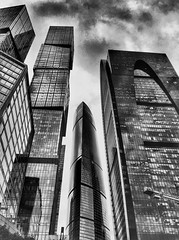 #Moscow #Blackandwhite (NO PHOTOGRAPHER) Tags: москвасити hochhaus gebäude cityscape skyline detail construction blackandwhite monochrome architecture architectural urban building outdoor iphoneography iphonephotography exterier russia moscowcity technoart sky clouds moscowphotography blue panorama panoramatic light shade dark shadow city geometric lookingup window skycraper iphone 6s skycrapers aboutlove analogy freestyle