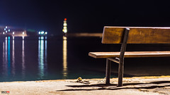 Take a seat and enjoy the view! (Snoopix_) Tags: sony a6000 a6k ilce6000 helios 44m4 bench lighthouse bokeh night nightphotgraphy chania crete greece oldharbour sea reflections
