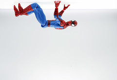 Nothing To See Here. Move Along Please. Just going About My Daily Spider Business (Skyline:)) Tags: spiderman tabletopphotography red blue funny humour whitebackground negativespace