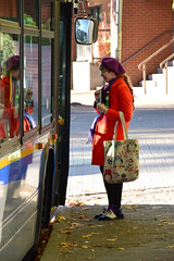 Bless all those who wear bright colours (James_D_Images) Tags: street candid person colourful clothes style dressed orange coat purple beret hat socks shoes wingtips bus window reflection open doors smile braid