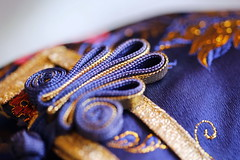 Chinese silk Cloth in blue (Christian Chene Tahiti) Tags: canon 6d paea tahiti macromondays cloth vêtement linge bouton boutonchinois auckland bleu blue jaune orange rouge ruban doré white couleur colour hmm macro bokeh closer closeup soie robe dress
