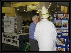 The 'Bradford' Rabbit Show. Rare Varieties (M E For Bees (Was Margaret Edge The Bee Girl)) Tags: thebradfordrabbitshow doncaster syorkshire canon outdoors stand white show tables hat ladies coat