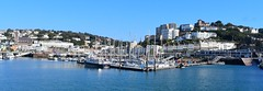 Torquay Marina (gillybooze) Tags: ©allrightsreserved vista sea sky hill architecture building panarama boats yacht trees mast pier reflections shadows buildings jetty shore seascape tree vehicle city bay wideangle torquay church