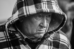 Older hoodie (Frank Fullard) Tags: frankfullard fullard candid street portrait older elderly hoodie head castlebar mayo face expression irish ireland monochrome black white blanc noir serious plaid wool cold weather clothes eyes beard stubble
