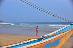 Beach walk (paaddor) Tags: beach beachscape beachphotography sandybeach fisherman boat woman walking breakingwater srilanka exploresrilanka exotic tropical paradise sea oceanview