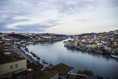 Douro (David AB Silva) Tags: river porto gaia douro city buildings houses sky morning cityscape clouds blue boats reflection water