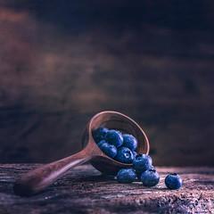 Blueberries (Ro Cafe) Tags: ddproject52 blackberries fruits nikkor105mmf28 round sonya7iii stilllife week6 berries food naturallight woodenspoon darkmood wood rustic textured