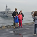 A Sailor and his family pose for a photo aboard USS Blue Ridge (LCC 19).