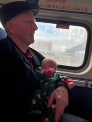 "Grandpa Miller Holds Luc on the Polar Express • <a style=""font-size:0.8em;"" href=""http://www.flickr.com/photos/109120354@N07/46389662212/"" target=""_blank"">View on Flickr</a>"