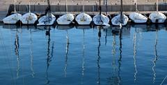 Barcelona and the sea(4): Mirrors/ Espejos (PURIFM) Tags: sea mar boat blue outside reflections barcelona azul water agua reflejos
