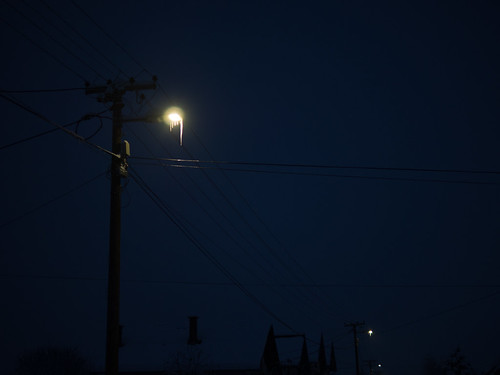 Hard winter. Long icicles on a street lamp