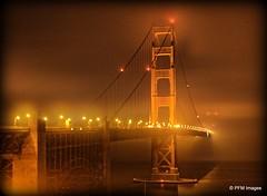 Foggy Foggy Night (pandt) Tags: fog foggy eerie goldengate bridge sanfrancisco california lights suspension night nighttime reflection mist misty outdoor water bay ocean landscape canon eos slr t1i flickr red orange