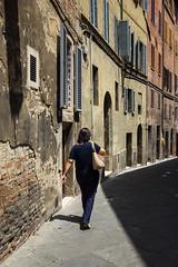 Siena 03 (Peter.Bartlett) Tags: bag people city doorway colour peterbartlett shutter urban candid wall woman walking lunaphoto urbanarte sign streetphotography ricohgr facade siena toscana italy it