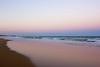 Iridescent Reflection of Sunset at Kawana Beach (do_japan) Tags: australia queensland sunshine coast kawana beach sand light sunset sky evening iridescent phosphorescent color wave sea ocean point cartwright lighthouse mooloolaba sailboat sail boat
