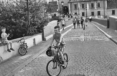 (deeluuu) Tags: blackandwhite bw children kids playing bike road analogue analog czarnobiałe ilfordhp5plus olympusom1n