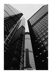 FILM - Skyline abstract-2 (fishyfish_arcade) Tags: analogphotography bw blackwhite blackandwhite delta3200 filmphotography filmisnotdead istillshootfilm kodak monochrome nikkor2880f3556afd nikonf70 tmaxp3200 analogcamera film mono london skyline skyscraper abstract architecture