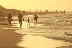 Sunset Walk (Pavlo Kuzyk) Tags: ocean beach couple man woman walking child canon