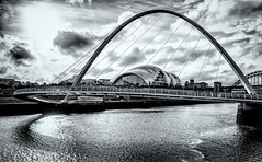 Arches [Explored] (Marc Rauw.) Tags: bridge newcastle newcastleupontyne britain uk arch arches architecture modern water tyne sky backlight schadow lightsandshadows lightsshadows light blackandwhite blackwhite black white bw monochrome gateshead gatesheadmillenniumbridge millennium olympusomdem5mkii olympus omd em5 microfourthirds μ43 m43 mzuiko1442mm mzuiko 1442mm pancake clouds travel