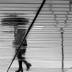 Under the floor (pascalcolin1) Tags: paris13 femme woman pluie rain reflets reflection parapluie umbrella sol floor photoderue streetview urbanarte noiretblanc blackandwhite photopascalcolin 50mm canon50mm canon