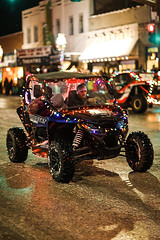 UTV With Christmas Lights (wyojones) Tags: wyoming cody christmasparade sheridanavenue snow cold sidebyside sxs offroadvehicle utv rov lights christmasseason parade man driver tailights wyojones
