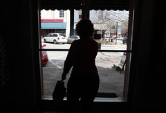 Bettye Scott, 59, an employee at Greene County High School, from Greensboro, Georgia, leaves the Maggie Lane Boutique in Downtown Greensboro, Georgia, with her shopping bag in hand.