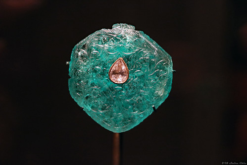Carved emerald and diamond pendant