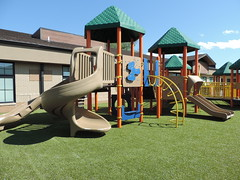 Child Development Center of Natrona County in Casper,  WY (ForeverLawn) Tags: cdc3 childdevelopmentcenterofnatronacounty playgroundgrass playgroundgrassbyforeverlawn playgroundgrassultra flcontest2018 foreverlawncentralwyoming adacompliantpark adaaccessible wheelchairaccessible playground outdoorplayarea slide swings park playarea inclusiveplay inclusiveplayground inclusivepark casper casperwyoming wyoming