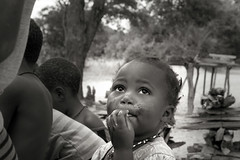 Child's Portrait _6330-2 (hkoons) Tags: southernafrica boysandgirls caprivistrip africa african boy caprivi namibia tree abode child children community folklore folks game games girl growth home house housing kids landscape outdoors plants play recreation residence residency residential roof rural sky sunlight thatch tile town traditions trees vegetation village youth