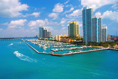 Aerial view of South Miami Beach and skycrappers (Transmundi2) Tags: america american apartments architecture beach boat buildings causeway city cityscape cloud dade dawn destinations district downtown florida highrise holidays horizontal luxury miami palm panoramic people port relaxation sea sky skyline skyscraper summer sunlight sunrise transport travel trees us usa vacation water waterfront yachts
