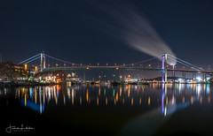 Night Bridge (Fredrik Lindedal) Tags: bridge lindedal gothenburg göteborg älvsborgsbron night longexpo sweden sverige smoke lights water reflections