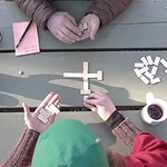 A game of dominoes keeps our spirits bright. thumbnail