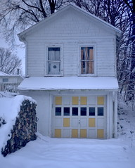 ten yellow panels (ejbarth) Tags: epl1 industar69 snow yellow garage