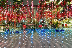 Curtains of Red and Blue (adrians_art) Tags: docklands canarywharf urban city isleofdogs nighttime redblue curtain abstractpatterns silhouetteshadow fairylights architecture winterlightsfestival