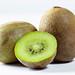 Ripe whole kiwi fruit and half kiwi fruit on white background