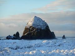 Snow covered Haystack Rock (Tide Fighter) Tags: haystackrock cannonbeach oregon oregoncoast pacificnorthwest snow snowy