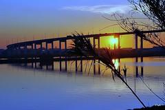 Reflexos do pôr do sol!! (puri_) Tags: rio água pôrdosol ponte reflexos céu núvens