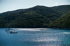 (Just A Stray Cat) Tags: lefkada greece sun summer travel holiday beach shore shoreline caustic sail sailing olympus mju ii canon wp1 as1 ae1 35mm film 35 mm analog analogue