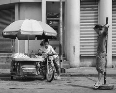 Parking (Beegee49) Tags: street monochrome blackandwhite bw motorcycle cart fruit vendor seller man men parking sony luminar skylum a 6000 bacolod city philippines asia