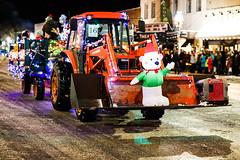 Tractor On Parade (wyojones) Tags: wyoming cody christmasparade christmasseason cold snow sheridanavenue tractor float bear lights generator handyman wagon christmas wyojones