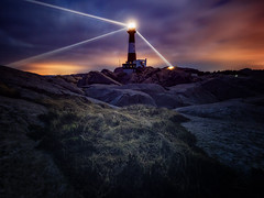 Guiding light (bjorns_photography) Tags: lighthouse night sky clouds landscape light view photography