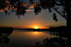 Atmospheric phenomenon (Dreaming of the Sea) Tags: sunset riversunset sliderssunday nikon nikond7200 water tamronsp2470mmf28divcusd reflections goldensunset goldenhour bundaberg queensland australia gumtrees clouds gimp hss