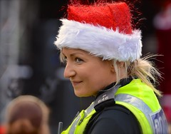 Santa On Duty (Edinburgh Photography) Tags: outdoors santa hat police woman portrait documentary photojournalism princes street gardens nikon d7000