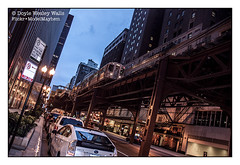 A Bit Elevated in Chicago (Doyle Wesley Walls) Tags: lagniappe 0578 theel thel chicago travel city street buildings urban cars bars lights railway train signs sky doylewesleywalls photo photograph chicagoillinois transportation