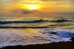 Sunrise - before & after that cloud (Fnikos) Tags: sea water mar mare wave foam espuma ocean landscape seascape coast beach shore seashore sidewalk sand dark light sun sunrise amanecer cloud sky skyline bay outdoor