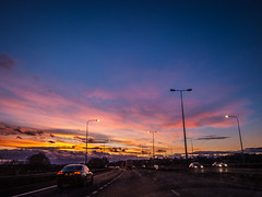 Sunset car winter multicoloured car view 4 (strangesimon) Tags: colours sunset sky dramatic landscape carscape view window car motorway blue orange clouds driving