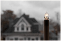 2019/024: A Beacon (Rex Block) Tags: abeacon nikon d750 dslr 50mm f18g gray rainy skies window screen homes candle light beacon project365 365the2019edition 3652019 day24365 24jan19