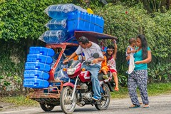 Make Room (Beegee49) Tags: street family motorcycle sidecar children tricycle baby mother carrying containers fully loaded bacolod city philippines asia panasonic lumix fz1000 happyplanet