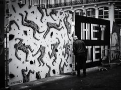 Hey, Eu! (Feldore) Tags: belgium brussels man peep peeping construction site street candid hoarding curious belgian photography feldore mchugh em1 17mm 18