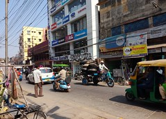 G.T. Road (Chiradeep.) Tags: streetcapture streetphotography streetsofkolkata streetcandid vehicle building sunnyday scooter town city calcutta kolkata westbengal india life documentary photojournalism aroundtheworld people asia gtroad grandtrunkroad huawei honor5c shop electronicsshop greateasterntrading